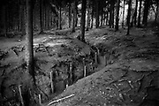 Verdun WW1 Battlefield site, Verdun-sur-Meuse, France. March 2014<br /> Seen here:<br /> The covered and fortified with concrete French 'London Communication Trench' which allowed supplies and relieving troops as well as hospital evacuation from the heights of Belleville and Douaumont day and night whilst under bombardment from the German guns. The construction avoided most of the caves in from attack or bad weather in this trench system.<br /> The Battle of Verdun lasted 9 months, 3 weeks and 6 days between 21 February and 20 december 1916. It was the longest and one of the most costly battles in human history;  recent estimates increase the number of casualties to 976,000.<br /> <br /> Caption information below from wikipedia:<br /> The Battle of Verdun (Bataille de Verdun0, was fought from 21 February – 18 December 1916 during the First World War on the Western Front between the German and French armies, on hills north of Verdun-sur-Meuse in north-eastern France. The German Fifth Army attacked the defences of the Région Fortifiée de Verdun (RFV) and the Second Army on the right bank of the Meuse, intending rapidly to capture the Côtes de Meuse (Meuse Heights) from which Verdun could be overlooked and bombarded with observed artillery-fire. The German strategy intended to provoke the French into counter-attacks and counter-offensives to drive the Germans off the heights, which would be relatively easy to repel with massed artillery-fire from the large number of medium, heavy and super-heavy guns, supplied with large amounts of ammunition on excellent pre-war railways, which ran within 24 kilometres (15 mi) of the front-line.<br /> <br /> The German strategy assumed that the French would attempt to hold onto the east bank of the Meuse, then commit the French strategic reserve to recapture it and suffer catastrophic losses from German artillery-fire, while the German infantry held positions easy to defend and suffered few losses. The German plan was based on the exp