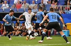 SAMARA, June 25, 2018  Roman Zobnin (2nd L) of Russia competes during the 2018 FIFA World Cup Group A match between Uruguay and Russia in Samara, Russia, June 25, 2018. (Credit Image: © Du Yu/Xinhua via ZUMA Wire)