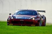 2012 FIA GT1 World Championship.Donington Park, Leicestershire, UK.27th - 30th September 2012.Filip Salaquarda / Marco Cioci, Ferrari 458 Italia GT3 goes off track...World Copyright: Jamey Price/LAT Photographic.ref: Digital Image Donington_FIAGT1-19096