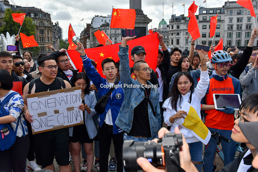Counter Protest: Pro-China singing China national song to show the kongers traitors of patriotism and the HK and their Gweilo support outnumber of the Pro-China and oversea Chinese supporters China in their event of 8.17 UK Solidarity with HK Rally. The Communist patriot singing (One China - One Nation) and they love HK. You dont need a human translator rights or wrong evil and good in Trafalgar square on 17 August 2019, London, UK.