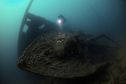 Diver approaching the bow of the wreck of the P&O liner Moldavia, which was sunk in WW1 off the south coast of England