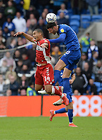 Cardiff City's Kieffer Moore beats Middlesbrough's Lee Peltier to the header <br /> <br /> Photographer Ian Cook/CameraSport<br /> <br /> The EFL Sky Bet Championship - Cardiff City v Middlesbrough - Saturday 23rd October 2021 - Cardiff City Stadium - Cardiff<br /> <br /> World Copyright © 2020 CameraSport. All rights reserved. 43 Linden Ave. Countesthorpe. Leicester. England. LE8 5PG - Tel: +44 (0) 116 277 4147 - admin@camerasport.com - www.camerasport.com