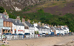 View of whitewashed terraced row of houses in Ullapool, Ross and Cromarty, Highland Region, Scotland, Uk