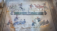 Wide picture of the Roman mosaics of the room of the Small Circus depicting Roman boys riding small chariots pulled by birds in a small circus, The Vestibule of The Smnall Circus, room no 41  at the Villa Romana del Casale, first quarter of the 4th century AD. Sicily, Italy. A UNESCO World Heritage Site.<br /> <br /> The Roman mosaic know as the Small Circus at the Villa Romana del Casale depicts a scene of a chariot race from the Circus Maximus in Rome. Two wheeled chariots, driven by children,  are racing around a central Pina (barrier) being drawn by fowl and web footed birds. The four chariots represent the four factions that raced against each other at the Circus and the tunics of the cild charioteers and the birds pulling their chariots are distinguished by the four different colours used by each faction. .<br /> <br /> If you prefer to buy from our ALAMY PHOTO LIBRARY  Collection visit : https://www.alamy.com/portfolio/paul-williams-funkystock/villaromanadelcasale.html<br /> Visit our ROMAN MOSAICS PHOTO COLLECTIONS for more photos to buy as buy as wall art prints https://funkystock.photoshelter.com/gallery/Roman-Mosaics-Roman-Mosaic-Pictures-Photos-and-Images-Fotos/G00008dLtP71H_yc/C0000q_tZnliJD08