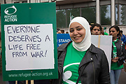 19 year old Bayan from Syria supporting Refugee Action, one of the 60 organisations supporting the 2016 Refugees Welcome Here march, calling on the government to do more to welcome refugees here in the UK. The march was organised by Solidarity with Refugees and held on the 17th of September 2016, Westminster, Central London, UK.