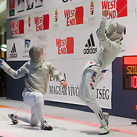 Kim Junghwan (R) of Korea reacts to scoring a point against Aron Szilagyi (L) of Hungary during the final of the Gerevich-Kovacs-Karpati Men's Sabre Grand Prix in Budapest, Hungary on March 09, 2014. ATTILA VOLGYI