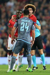 11th May 2017 - UEFA Europa League - Semi Final (2nd Leg) - Manchester United v Celta Vigo - Eric Bailly of Man Utd (L) is held back by teammate Marouane Fellaini as he reacts to Facundo Roncaglia of Celta Vigo - Photo: Simon Stacpoole / Offside.