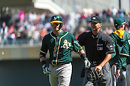 Josh Donaldson #20 of the Oakland Athletics is led off the field by home plate umpire Vic Carapazza following an on-field argument against the Minnesota Twins on April 9, 2014 at Target Field in Minneapolis, Minnesota.  The Athletics defeated the Twins 7 to 4.  Photo by Ben Krause