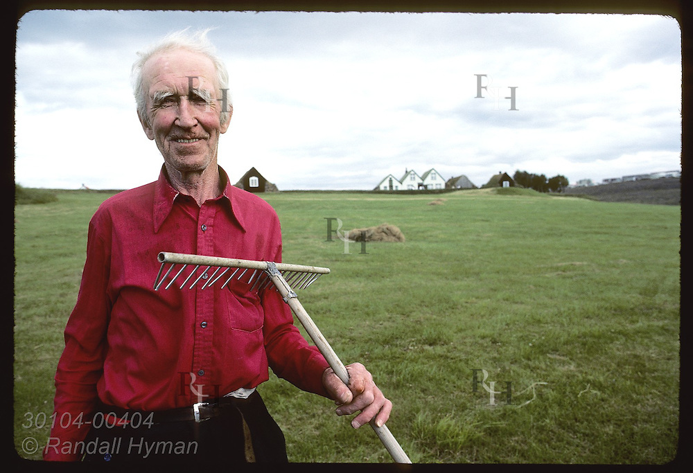 Bjorgvin Agustsson poses @ Arbaer Folk Museum-- both he and rake are missing a tooth; Reykjavik Iceland