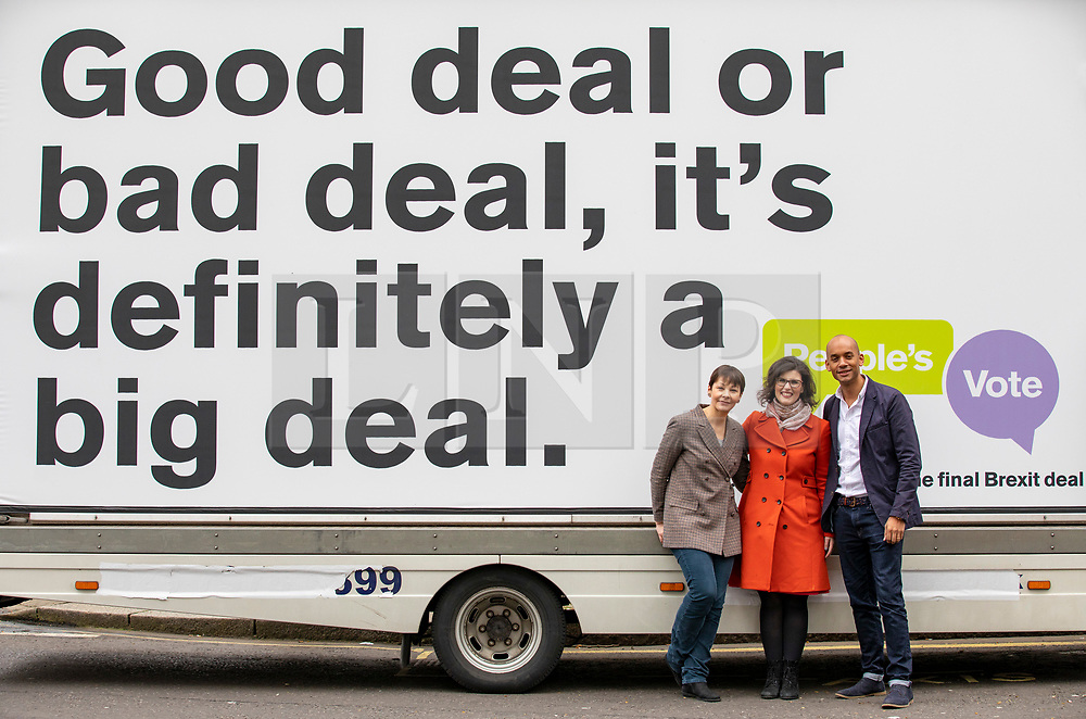 © Licensed to London News Pictures. 15/04/2018. London, UK. Green Party Co-Leader CAROLINE LUCAS (L), Liberal Democrat LAYLA MORAN (C) and Labour MP CHUKA UMUNNA (R) stand in front of an ad van from the campaign group People's Vote, which is calling for a public vote on the final Brexit deal. Photo credit: Rob Pinney/LNP
