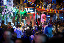 """© Licensed to London News Pictures . 22/08/2014 .  Manchester , UK . The scene on Canal Street as the evening wears on . Manchester Pride """" Big Weekend """" in Manchester's """" Gay Village """" today ( 22nd August 2014 ) . Photo credit : Joel Goodman/LNP"""