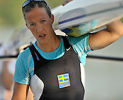 Banyoles, SPAIN, SWE W1X Frida SVENNSON, carrying the pair FISA World Cup Rd 1. Lake Banyoles  Saturday,  30/05/2009   [Mandatory Credit. Peter Spurrier/Intersport Images]