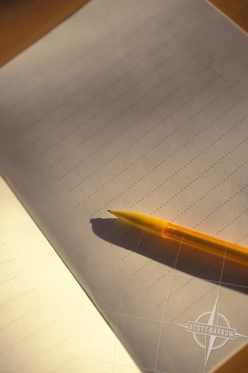 Lined notebook with pencil.