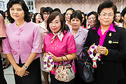 09 OCTOBER 2014 - BANGKOK, THAILAND: Women line up to pray for Bhumibol Adulyadej, the King of Thailand in the lobby of Siriraj Hospital. The King has been hospitalized at Siriraj Hospital since Oct. 4 and underwent emergency gall bladder removal surgery Oct. 5. The King is also known as Rama IX, because he is the ninth monarch of the Chakri Dynasty. He has reigned since June 9, 1946 and is the world's longest-serving current head of state and the longest-reigning monarch in Thai history, serving for more than 68 years. He is revered by the Thai people and anytime he goes into the hospital thousands of people come to the hospital to sign get well cards.   PHOTO BY JACK KURTZ