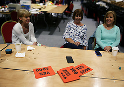 Vote counters sit back after completing their count at the count centre in Dublin's RDS as votes are counted in the referendum on the 8th Amendment of the Irish Constitution which prohibits abortions unless a mother's life is in danger. Picture date: Saturday May 26, 2018. See PA story IRISH Abortion. Photo credit should read: Brian Lawless/PA Wire