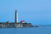 One of Canada's tallest lighthouses on rugged cliffs at the entrance of the Gulf of St. Lawrence<br /> Cap-des-Rosiers Lighthouse National Historic Site of Canada<br /> Cap-des-Rosiers<br /> Quebec<br /> Canada