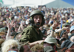 Fan wearing an army type helmet at the main stage on Sunday 10th July, 2005 at the two-day T in the Park festival, at Balado, Kinross-shire, Scotland..