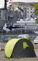 © Licensed to London News Pictures. 10/09/2013. London, UK. A tent belonging to 'Occupy vs the Arms Fair' protesters is seen outside the Defence Security and Equipment International (DSEI) exhibition in London today (10/09/2013). The biennial event, held at the at the Excel Centre in London's Docklands, is one of the world's largest with around 1350 exhibitors from 40 countries across the world. Photo credit: LNP