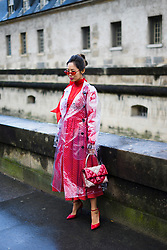 Aimee Song poses wearing a Burberry trench coat and Valentino dress and bag after the Valentino show at Les Invalides during Paris Fashion Week Womenswear FW 18/19 on March 4, 2018 in Paris, France.   (Photo by Nataliya Petrova/NurPhoto/Sipa USA)