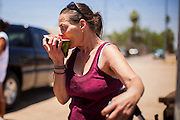 "20 JUNE 2012, PHOENIX, AZ:  A homeless woman eats watermelon provided by ""I Will Listen"" in Phoenix, AZ, Wednesday. June 20 is the first day of summer in the northern hemisphere. The high temperature in Phoenix Wednesday soared to over 110 (F), well above the normal of 105. The hot weather is especially stressful on the homeless, who don't have the opportunity to get into air conditioning or access to cold water. ""I Will Listen,"" an outreach organization that assists the homeless and community of street people in Phoenix, AZ, provides free food and cold drinks to the homeless in central Phoenix. They ran out of drinks and food in about one hour during Wednesday's outreach.       PHOTO BY JACK KURTZ"