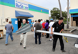 September 7, 2017 - Ft. Lauderdale, FL, USA - Jonathan Iovino from Boca Raton and Omar Torres from Miami load up with hurricane shutters from the Habitat for Humanity Restore on Broward Blvd. There was a line out the door to purchase shutters.  (Credit Image: © Sun-Sentinel via ZUMA Wire)