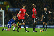 Paul Pogba of Manchester United (r) reacts to having a free kick awarded against him for his tackle on Tom Davies of Everton (l). Premier league match, Everton v Manchester Utd at Goodison Park in Liverpool, Merseyside on New Years Day, Monday 1st January 2018.<br /> pic by Chris Stading, Andrew Orchard sports photography.