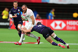 March 9, 2019 - Vancouver, BC, U.S. - VANCOUVER, BC - MARCH 09:  Tom Bowen (8) of England is tackled by Robbie Fergusson (4) of Scotland during day 1 of the 2019 Canada Sevens Rugby Tournament on March 9, 2019 at BC Place in Vancouver, British Columbia, Canada. (Photo by Devin Manky/Icon Sportswire) (Credit Image: © Devin Manky/Icon SMI via ZUMA Press)