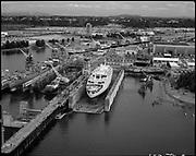 "Ackroyd 19859-2. ""NWMIW. Renaissance. July 29 1976"" (Northwest Marine Iron Works. ship Renaissance in Swan Island drydock bay.)"