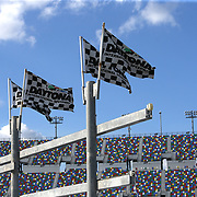 Flags are seen in the fan zone during practice for the 60th Annual NASCAR Daytona 500 auto race at Daytona International Speedway on Friday, February 16, 2018 in Daytona Beach, Florida.  (Alex Menendez via AP)