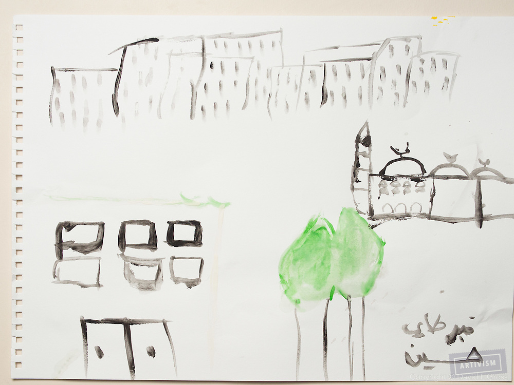 Before the war (?): A hospital at the top, a mosque to the right. Two trees. Drawing by a 10 year old Syrian boy. (Topic for session: draw your impression of life before, during and after the war.)