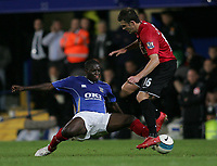 Photo: Lee Earle.<br /> Portsmouth v Manchester United. The FA Barclays Premiership. 15/08/2007.Portsmouth's Sulley Muntari (L) was sent off for this tackle on United's Michael Carrick.