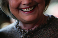 Democratic U.S. presidential candidate Hillary Clinton greets people at Octane coffee shop during a campaign stop in Atlanta City Hall in Atlanta, Georgia February 26, 2015.   REUTERS/Christopher Aluka Berry