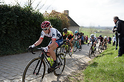 Through gritted teeth, Lisa Klein reaches the final metres of Paterberg at Dwars door Vlaanderen 2017. A 114 km road race on March 22nd 2017, from Tielt to Waregem, Belgium. (Photo by Sean Robinson/Velofocus)