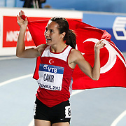 Turkey's Asli Cakir blows to the crowd as she celebrates her bronze medal in the women's 1500m final  during the IAAF World Indoor Championships at the Atakoy Athletics Arena, Istanbul, Turkey. Photo by TURKPIX