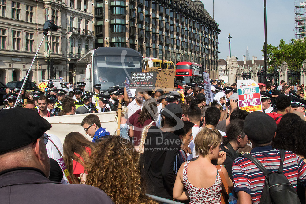 London, June 21st 2017. Protesters march through London from Sheherd's Bush Green in what the organisers call 'A Day Of Rage' in the wake of the Grenfell Tower fire disaster. The march is organised by the Movement for Justice By Any Means Necessary and coincides with the Queen's Speech at Parliament, the destination. PICTURED: Protesters block the road outside the Houses of Parliament.