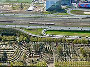 Nederland, Noord-Holland, Amsterdam; 16-04-2021; Zuidas met zicht op de Rooms-Katholieke Begraafplaats Buitenveldert. Aan de andere zijde van de Ring A10 sportvelden van SC Buitenveldert, kantoor van Deloitte en een deel van de VU.<br /> Zuidas with a view of the Roman Catholic Cemetery Buitenveldert. On the other side of the Ring A10 sports fields of SC Buitenveldert, Deloitte office and part of the VU.<br /> <br /> luchtfoto (toeslag op standard tarieven);<br /> aerial photo (additional fee required)<br /> copyright © 2021 foto/photo Siebe Swart