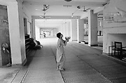 A boy plays ball in a mosque. Also known as Qadiani's The Ahmadiyyas are the followers of Hazrat Mirza Ghulam Ahmad Qadiani (1835-1908). According to his followers, he was the  founder of the Ahmadiyya Muslim Jama'at and The Promised Messiah and Imam Mahdi. The Ahmadiyya (Qadiani) movement in Islam is a religious organisation with more than 30 million members worldwide. Ahmadiyyas are now banned from calling themselves Muslim in Pakistan and suffer terrible discrimination under anti-blasphemy laws and are regularly murdered for their faith.