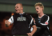 Photo: Paul Greenwood.<br />Port Vale v Swansea City. Coca Cola League 1. 18/11/2006. Swansea's Lee Trundle, left, starts the celebrations with Thomas Butler