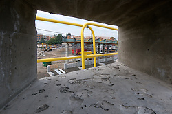 View through opening in Bridge Abutment during Construction Progress of the Railroad Station at Fairfield Metro Center, Site visit 14