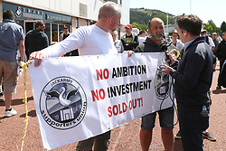 Swansea fans hold up a banner before the game during the Premier League match at the Liberty Stadium, Swansea.