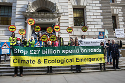 XR Roads Rebellion activists protest outside the Treasury against the UK government's £27.4bn roads programme on 21st October 2021 in London, United Kingdom. Environmental activists from groups including Extinction Rebellion argue that plans by the government to build new trunk roads are inconsistent with the UK's climate commitments and should be cancelled in the Autumn Spending Review.