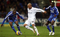 Photo: Paul Thomas.<br /> Bolton Wanderers v Chelsea. The Barclays Premiership. 29/11/2006.<br /> <br /> El Hadji Diouf of Bolton (C) tries to get away from Geremi (L) and Claude Makalele.