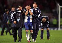 Photo: Paul Thomas.<br /> Espanyol v Sevilla. UEFA Cup Final. 16/05/2007.<br /> <br /> Penalty miss taker, Luis Garcia (C) of Espanyol, gets consoled by team-mates.