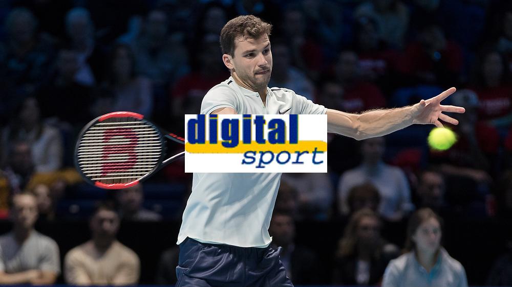 Tennis - 2017 Nitto ATP Finals at The O2 - Day Two<br /> <br /> Group Pete Sampras Singles: Dominic Thiem (Austria) Vs Grigor Dimitrov (Bulgaria)<br /> <br /> Grigor Dimitrov (Bulgaria) opens himself up to return serve at the O2 Arena <br /> <br /> <br /> COLORSPORT/DANIEL BEARHAM