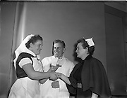 04/11/1955<br /> 11/04/1955<br /> 04 November 1955<br /> Cerebos special presentation for Bisto competition winner at Monaghan for McConnell's. Nurse being congratulated by colleagues on winning one of the cheques.