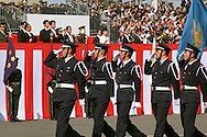 """October, 23, 2016, Asaka, Saitama Prefecture: Japanese Prime Minister Shinzo Abe proudly reviews his nation's military might during an annual review of the Japan Self Defense Force (JSDF), held at the Asaka Training Area on the outskirts of Tokyo. For this event, PM Abe, top ranking Japanese brass and international dignitaries were in attendance to view Japan's military prowess. This included 4000 troops, 27 divisions, 280 vehicles and artillery, plus 50 aircraft of the Ground, Air, and Maritime branches of the JSDF. Since the post WW II era, Japan has been a pacifist nation with it's constitution drafted by the Allied Occupation in 1947. But Since PM Shinzo Abe took office in 2012, he's had an agenda to revise the constitution which would permit Japan greater autonomy outside it's borders. In December 2013, Abe announced a five year plan of military expansion described as """"proactive pacifism"""", with the goal of making Japan """"a more normal country"""", able to defend itself. This was in reaction to China's buildup of it's military and territorial disputes with Japan, as well as a decreased American influence in the region. This is also a matter of national pride as Japan has been trying to wash away it's past aggressions of WW II. (Torin Boyd/Polaris)."""
