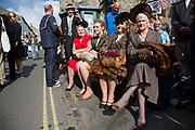 Grassington 1940s Weekend event held annually in the village Grassington in the Yorkshire Dales, England, UK. Local people join in with mass re-enactment commemorating World War II spirit with military and vintage clothing, military vehicles and dancing. Ladies with their furs.
