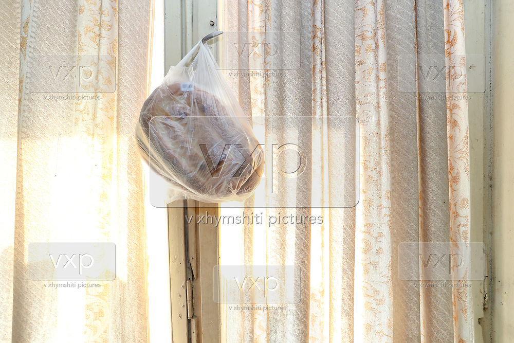 """A piece of bread is seen hanged on the window of the Veronica's living room on Tuesday, Dec 28, 2020. She said that they will not return to Nagorno Karabakh. They're now under Armenian government logistics support for food, shelter and other essential supplies. The family is living at an abandoned building of former """"SOVIET Hotel"""" in Metsamor, which is located near the Armenian Nuclear Power Plant, that is the only nuclear power plant in the South Caucasus, located 36 kilometres west of Yerevan in Armenia. (Photo/ Vudi Xhymshiti)"""