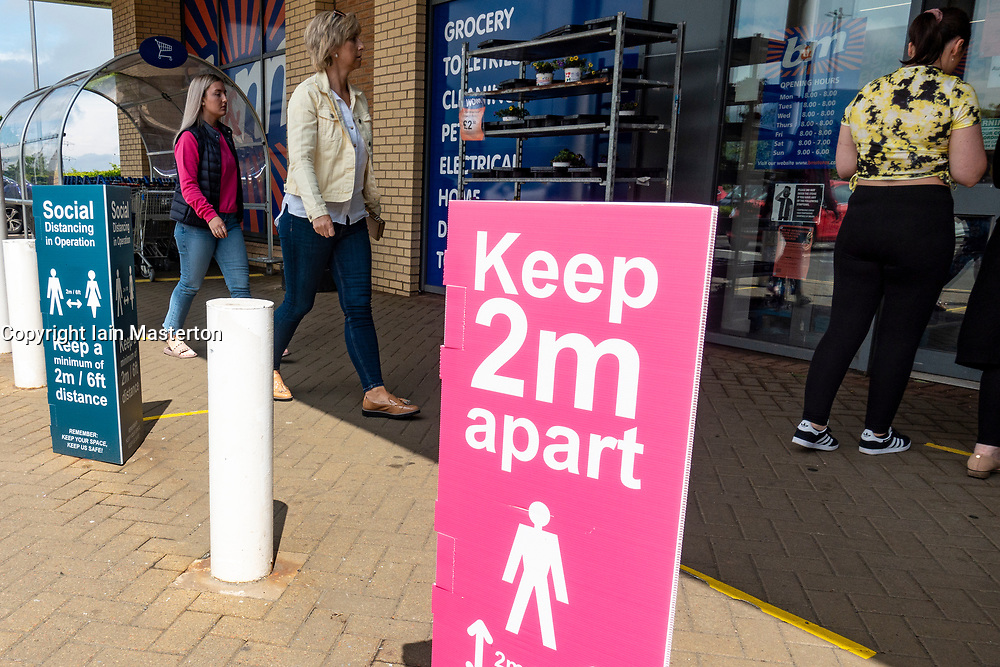 Edinburgh, Scotland, UK. 19 June, 2020. Several shops at Straiton Retail Park outside Edinburgh have opened. Signage warning customers to maintain 2m social distancing is positioned outside and inside shops. Iain Masterton/Alamy Live News
