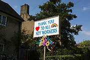 With the promise of the UK governmens Corinavirus lockdown being relaxed within a couple of few days, local Fine Art artist Kevin McKeon whose arts practice is normally figurative and heritage carving projectshas made a placard tribute and thanks to NHS National Health workers who pass-by his home in Herne Hill in south London, on 7th May 2020, in London, England.